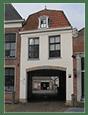 Contact - ingang richting atelier Zicht op Atelier Merk 17